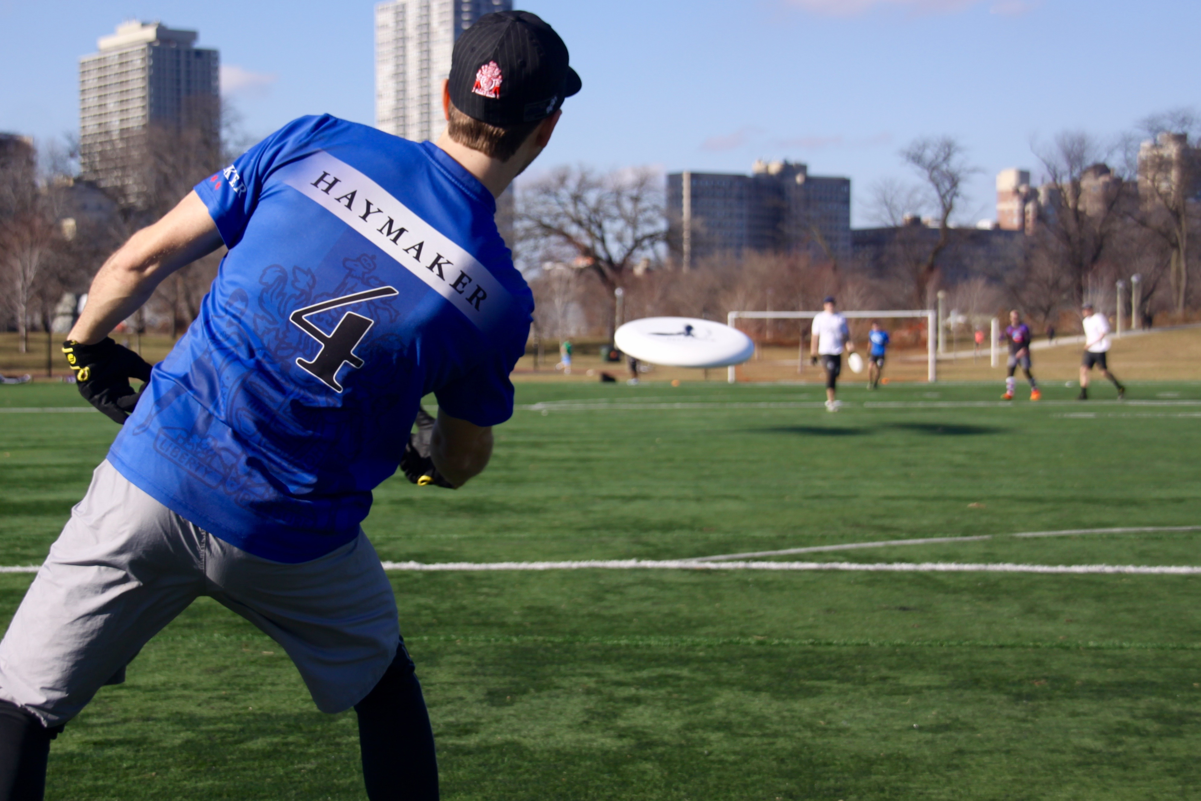 "DePaul Ultimate Club coach Jake Ward encourages everyone to give it their all during a one-on-one deep toss drill on Jan. 21, 2017, because as he says, ""Ultimate teams are made in the winter."" (Photo/Ben Rains)"