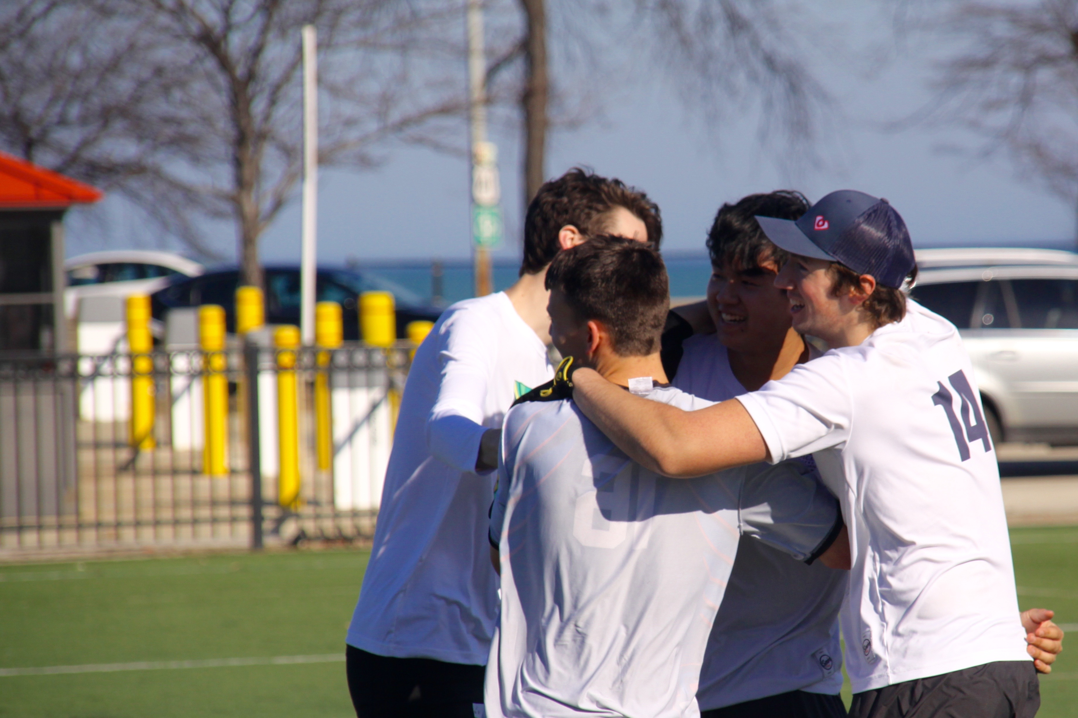 "DePaul Ultimate Club teammates celebrate after scoring a ""goal"" during a scrimmage at a Saturday morning practice on Jan. 21, 2017. (Photo/Ben Rains)"