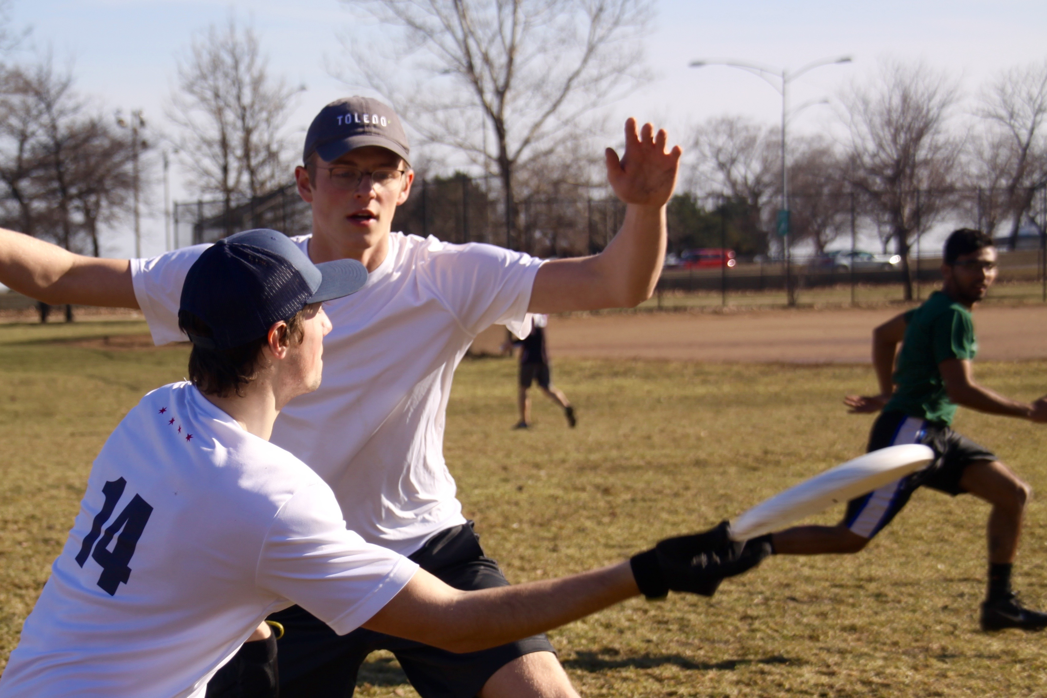 Tony Paoli, guarded by Jacob Dziubek, attempts a throw to Nitin Thomas during a drill at a DePaul Ultimate Club practice on Jan. 21, 2017. (Photo/Ben Rains)