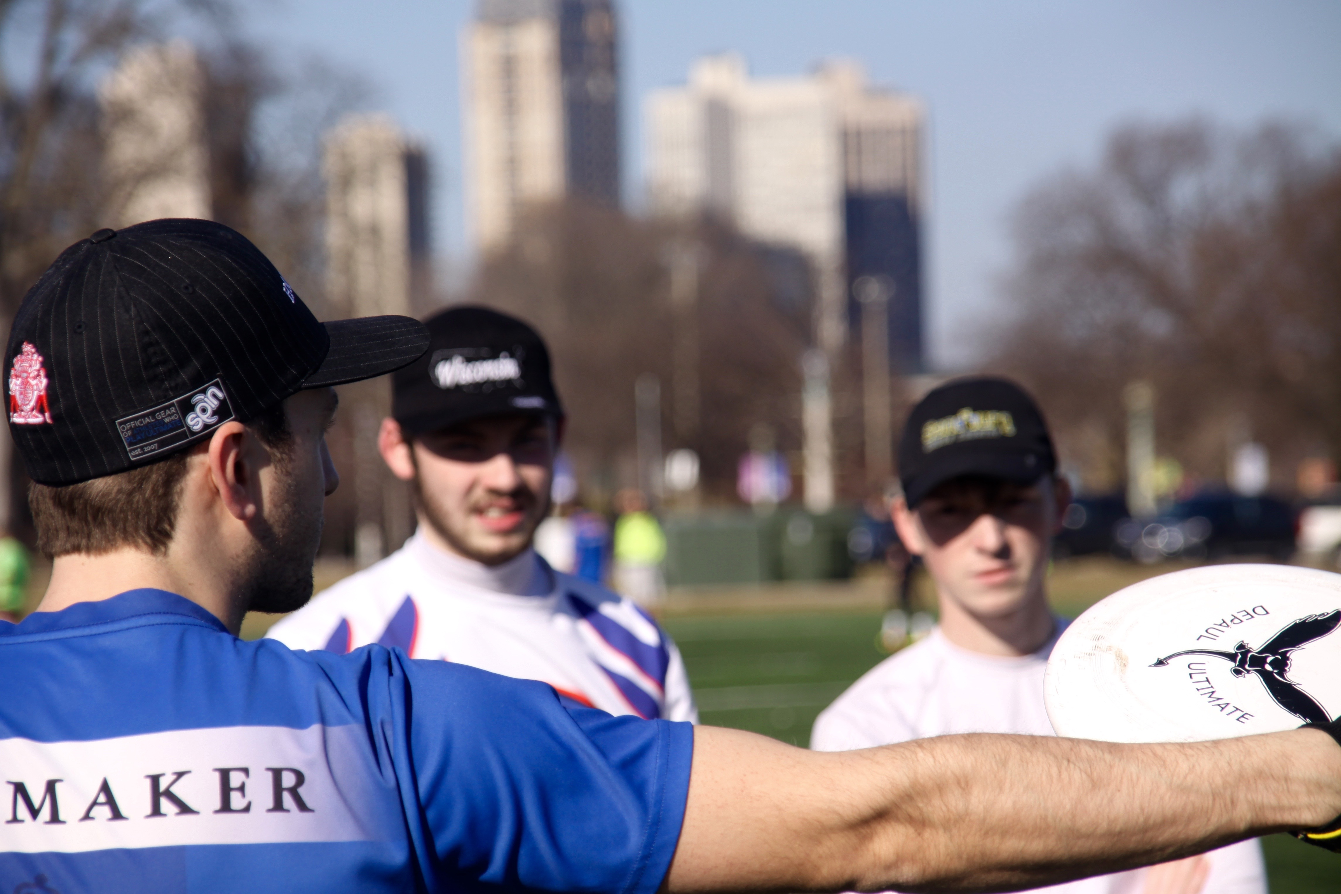 DePaul Ultimate Club coach Jake Ward provides instructions for the next team drill during a practice on Jan. 21, 2017. (Photo/Ben Rains)