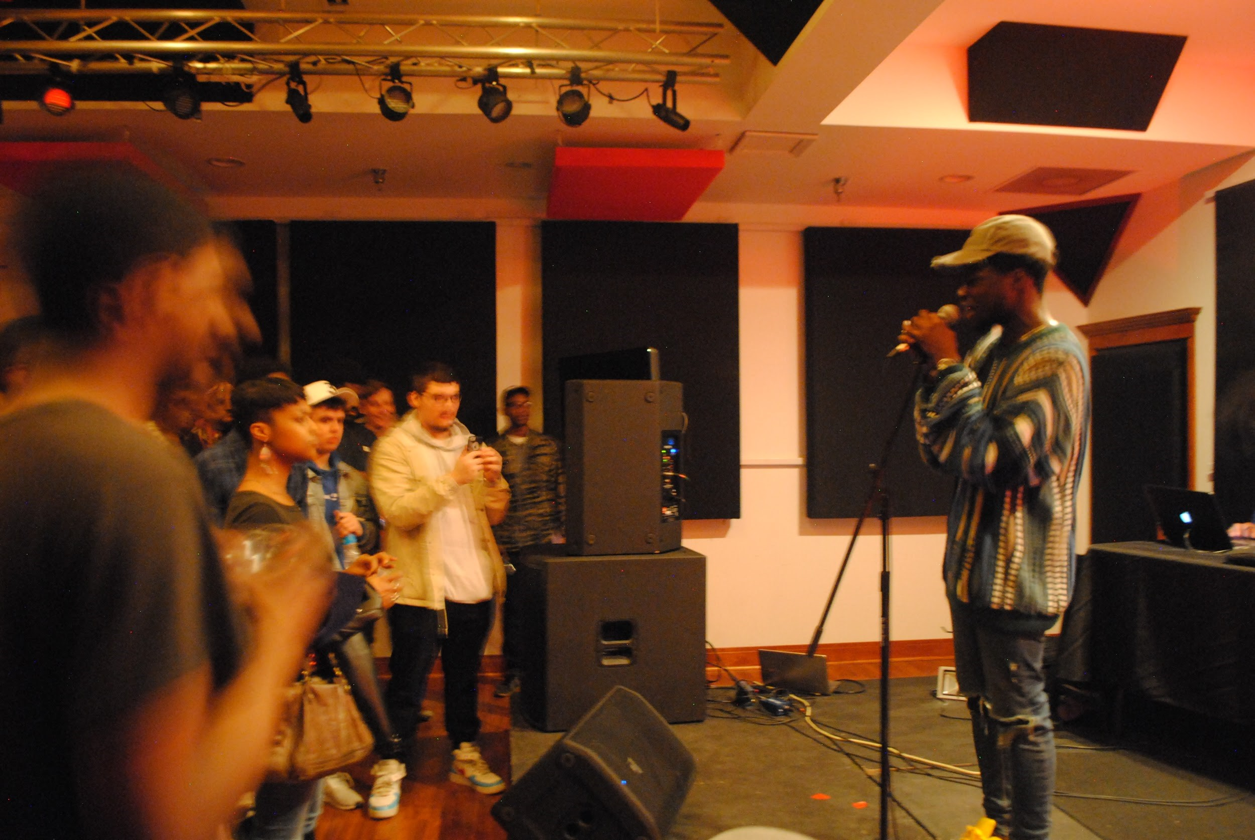 Femdot speaking to the crowd at Icon Pro Studios. (Alexandra Amendola, 14 East Magazine)