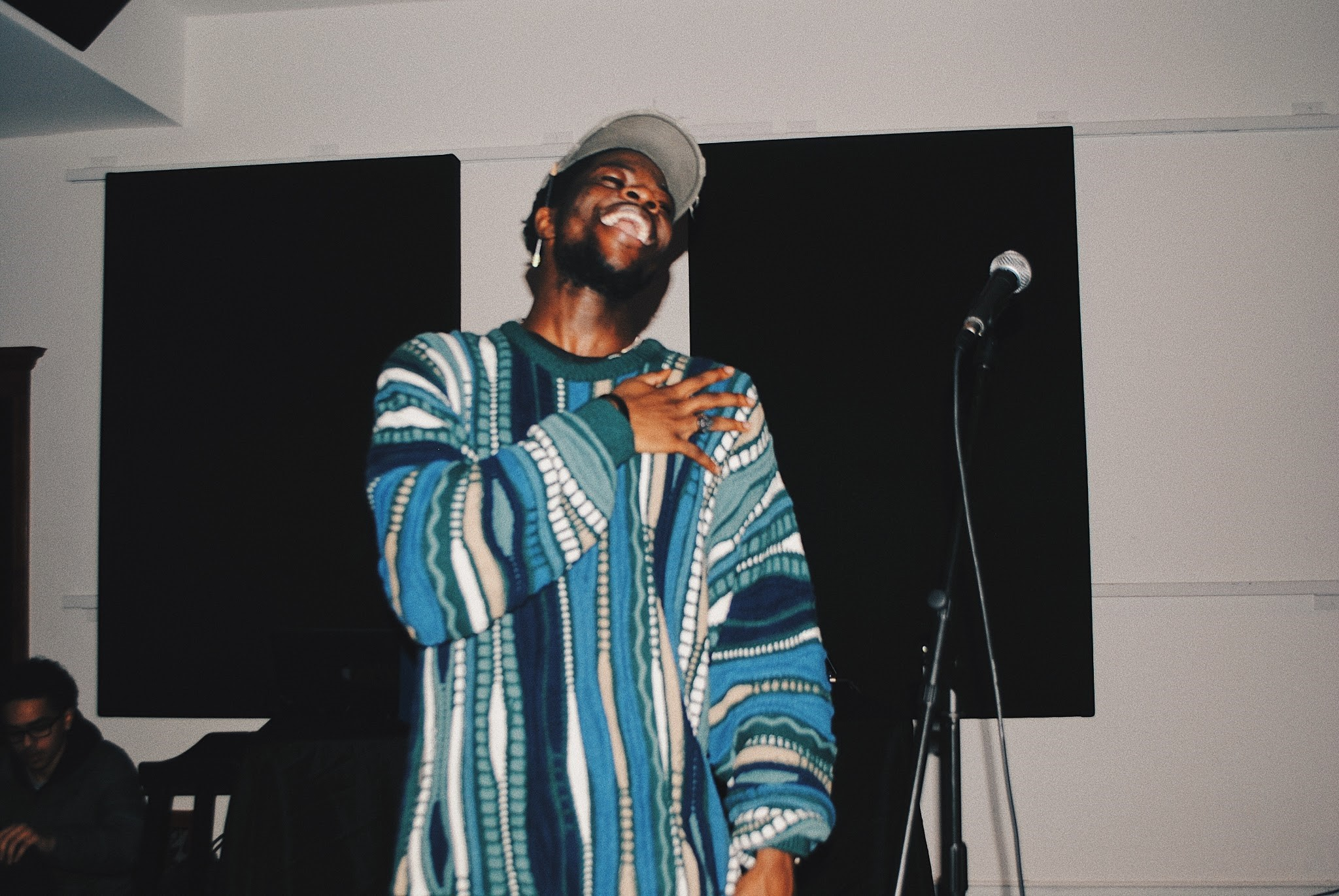Femdot laughing on stage after his set. (Alexandra Amendola, 14 East Magazine)