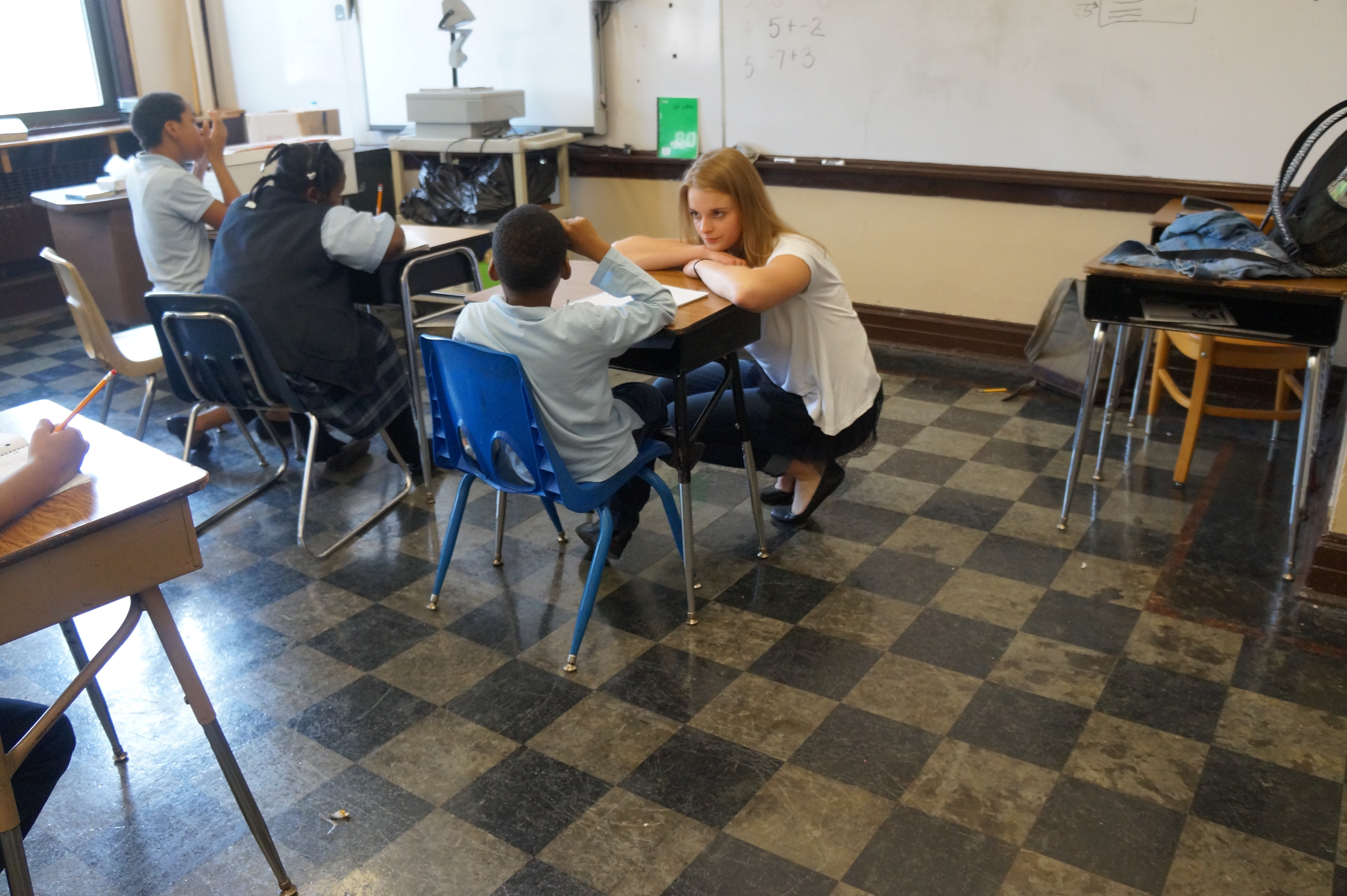 Bozich assists students with math problems. (Kira Latoszewski, 14 East)