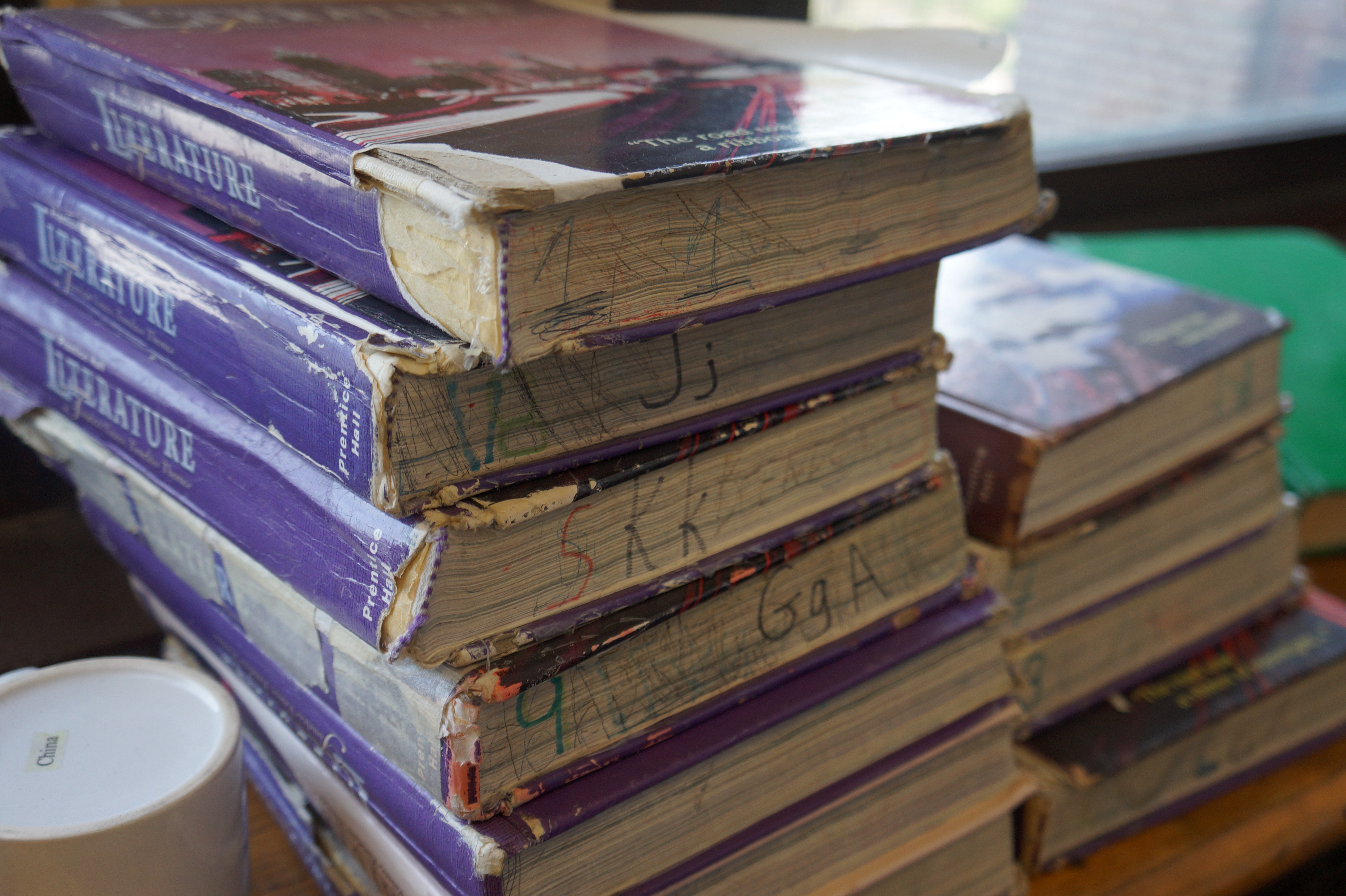 Outdated and battered textbooks that have rental dates from the year 2000 are still used at the school. (Kira Latoszewski, 14 East)