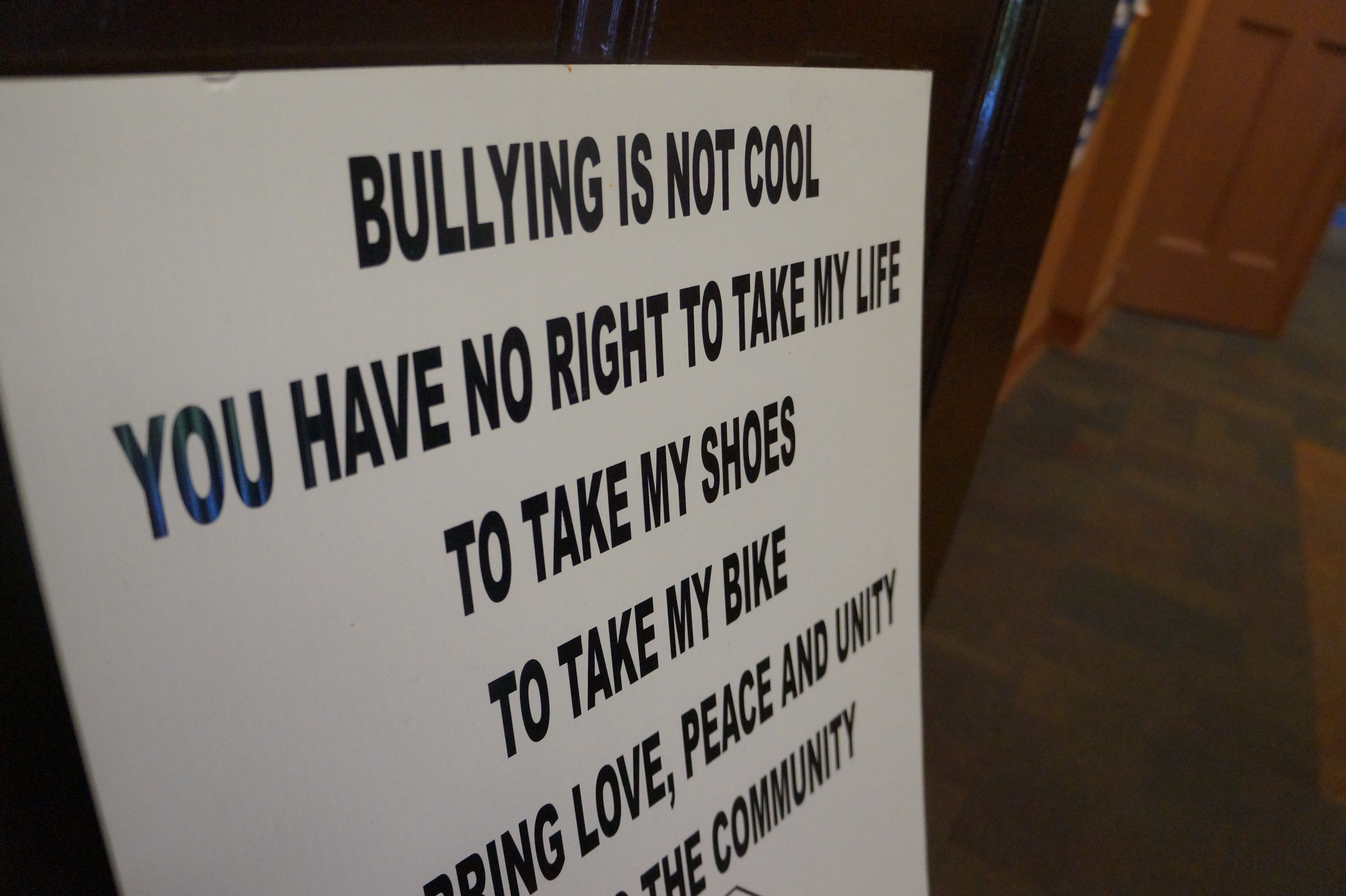 An anti-violence sign hanging in St. Sabina Academy. (Kira Latoszewski, 14 East)
