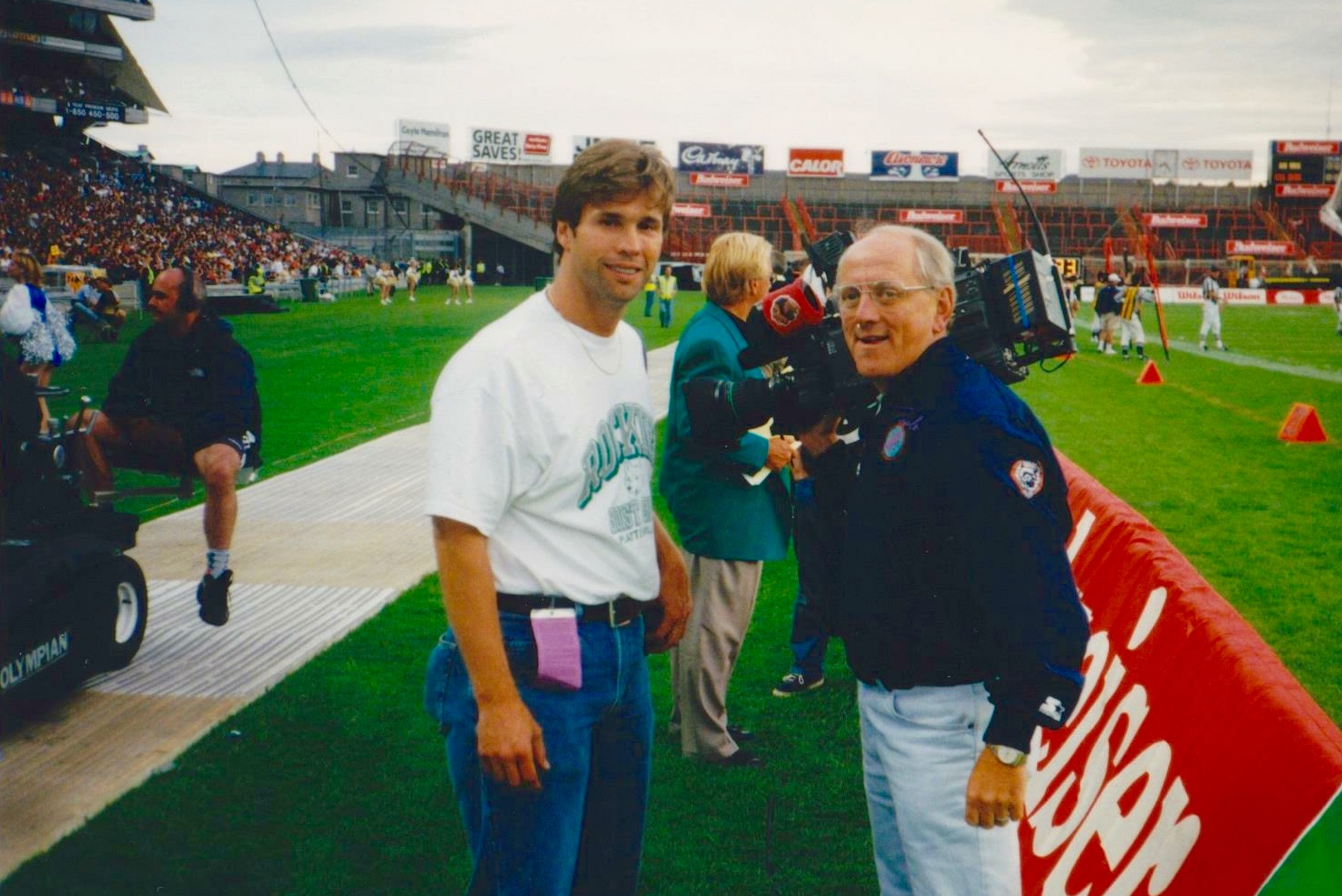 Davidson (right) with local cameraman Larry Collins. Photo Courtesy of Chuck Davidson.