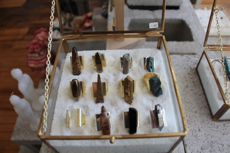Handmade rings sit in a display case. Ghouleh works with natural stones both for their decorative and metaphysical characteristics. (Camille Squires, 14 East)