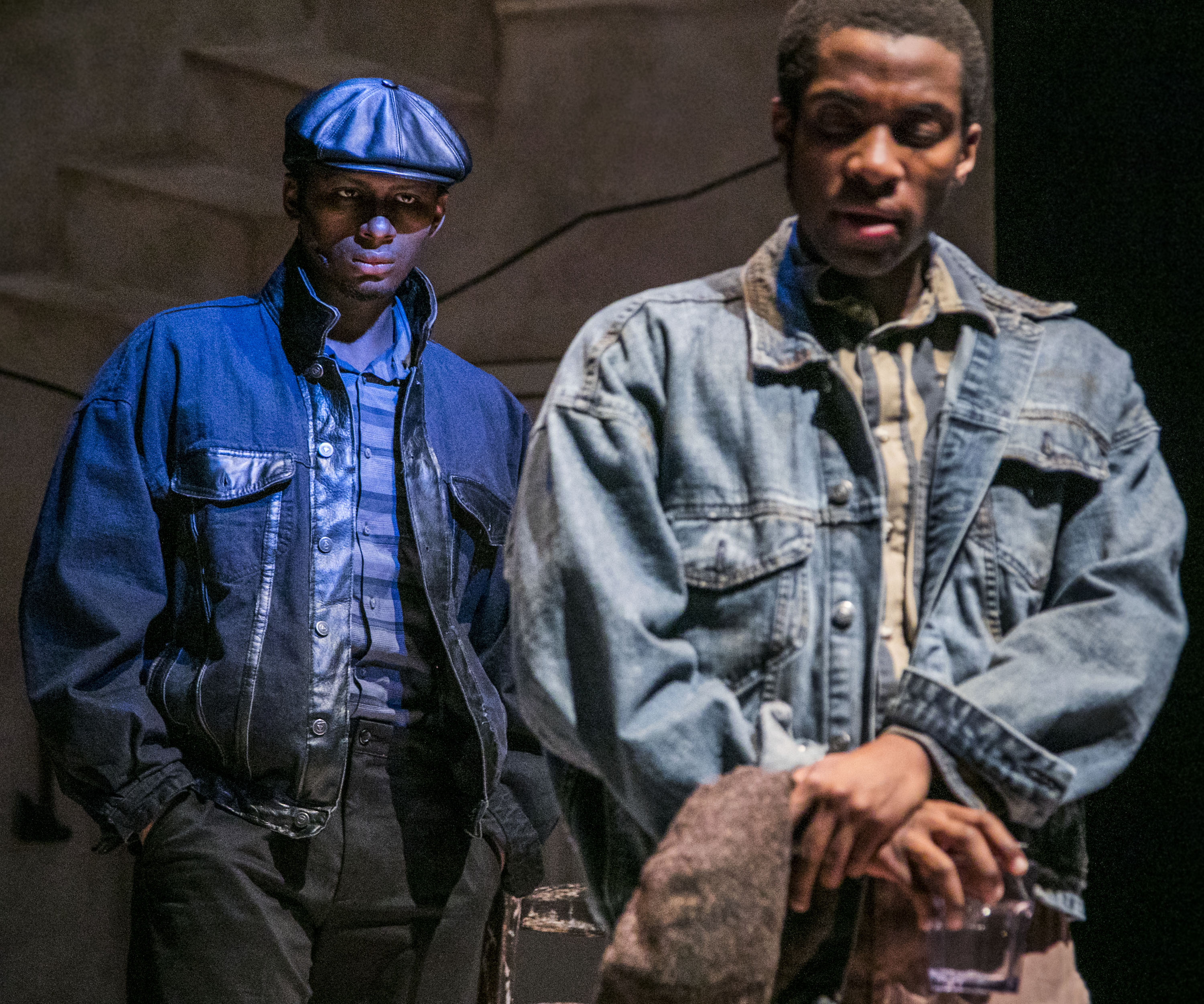 "Bigger Thomas (Matthew James Elam), right, battles his ever present inner demon, Black Rat (Michael Morrow) in a scene from The Theatre School's production of ""Native Son,"" currently playing on the Fullerton Stage Feb. 9-18, 2018. Set in South Side Chicago in the 1930s, Bigger Thomas lands a job with a wealthy white family, but his fate is sealed when a violent act unleashes a chain of events that cannot be undone. The play, based on the novel by Richard Wright, is directed by DePaul graduate student Mikael Burke, and explores the systemic racism and poverty that oppressed Bigger Thomas from birth. (DePaul University/Jamie Moncrief)"