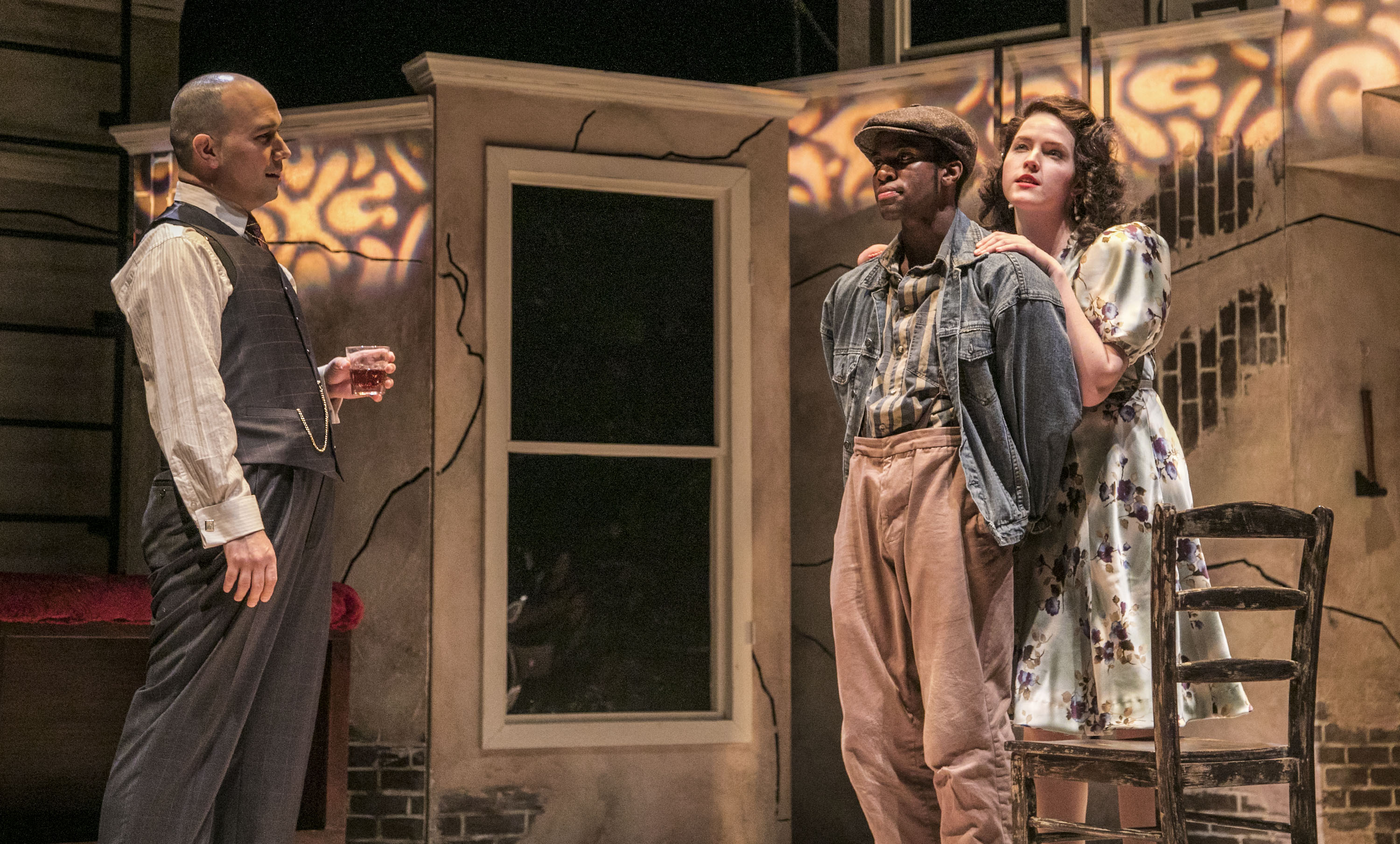 "Mary (Delany Feener) flirts with Bigger Thomas (Matthew James Elam) in front of her father, Mr. Dalton (Matthew Hannon), left, in a scene from The Theatre School's production of ""Native Son,"" currently playing on the Fullerton Stage Feb. 9-18, 2018. Set in 1930s South Side Chicago, Bigger Thomas lands a job with a wealthy white family, but his fate is sealed when a violent act unleashes a chain of events that cannot be undone. The play, based on the novel by Richard Wright, is directed by DePaul graduate student Mikael Burke, and explores the systemic racism and poverty that oppressed Bigger Thomas from birth. (DePaul University/Jamie Moncrief)"