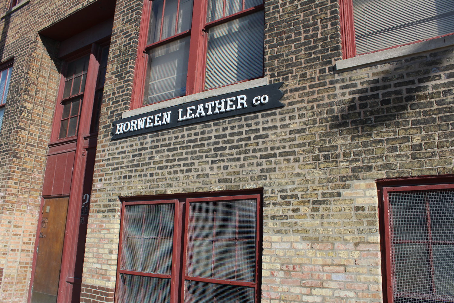 The brick and red-accented building front of Horween Leather Co.