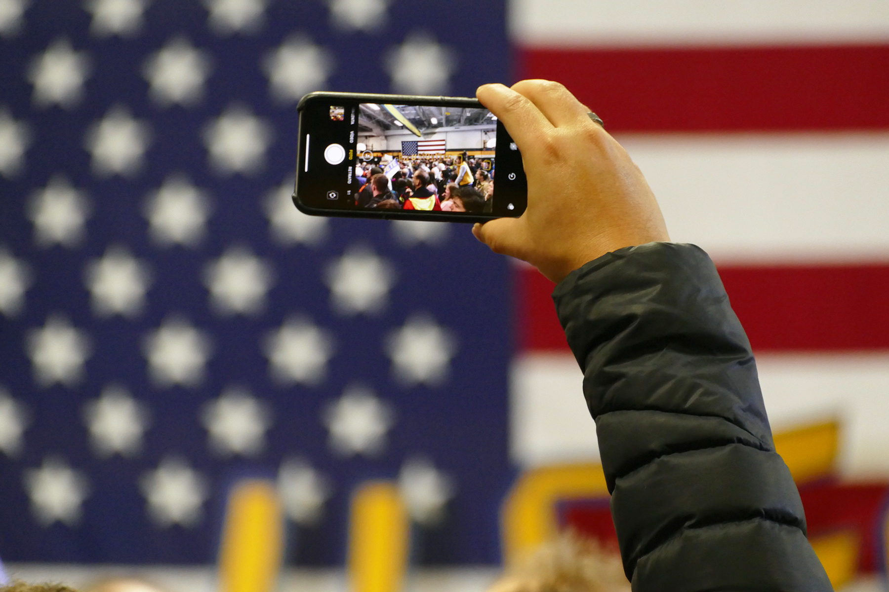 Iowan taking a photo at Buttigieg's rally. (Marissa Nelson, 14 East)