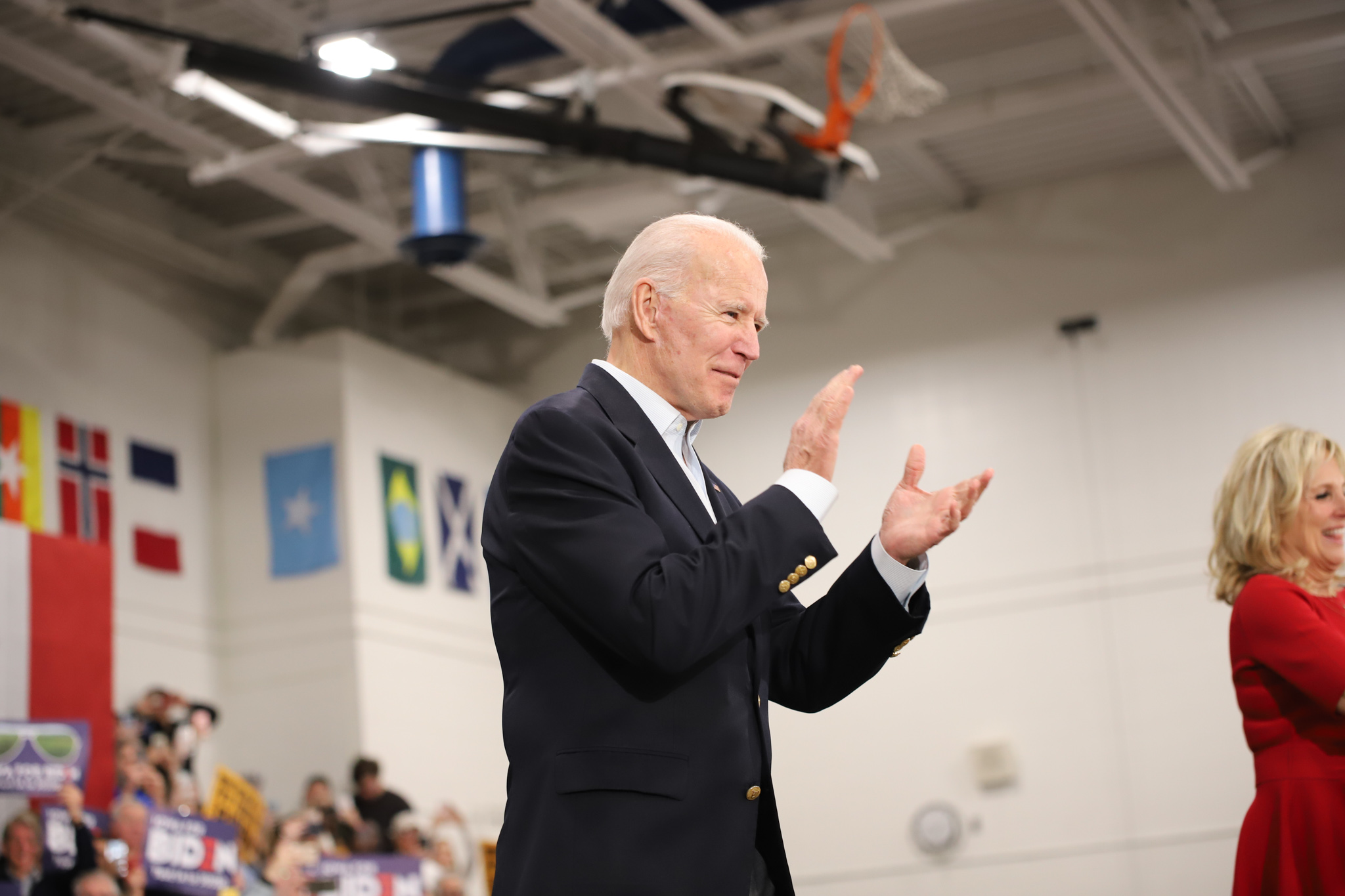 Biden clapping with wife, Jill, at campaign event. (Brita Hunegs, 14 East)